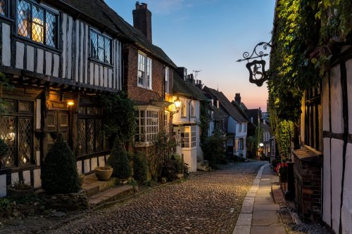 Half timbered Tudor houses on a cobbled street at dusk in Rye, East Sussex