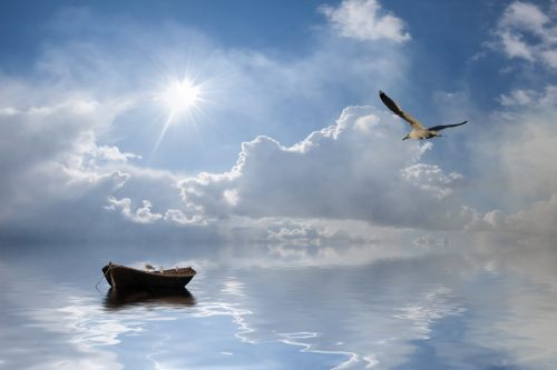 Landscape with lonely boat and birds against a sun, majestic clouds in sky